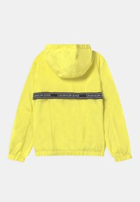 Calvin Klein Jeans - LOGO TAPE UNISEX - Light jacket - yellow - 1