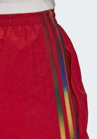 adidas Originals - PAOLINA RUSSO ADICOLOR SPORTS INSPIRED MID RISE PANTS - Tracksuit bottoms - scarlet - 6