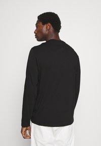 Armani Exchange - Long sleeved top - black - 2