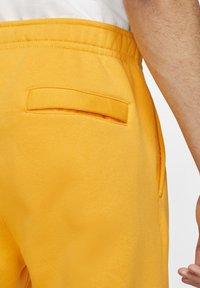 Nike Sportswear - CLUB - Tracksuit bottoms - university gold/white - 2