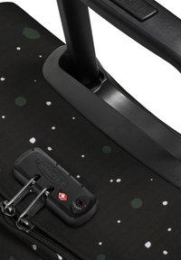 Eastpak - TRANVERZ - Wheeled suitcase - splashes dark - 4