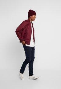Tommy Jeans - SCANTON - Slim fit jeans - black iris - 1