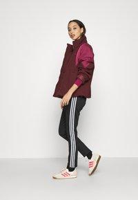 adidas Originals - SHORT PUFFER - Winter jacket - maroon/power berry - 1