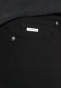 The Kooples - WASHED SLIM WITH ZIPPER DETAIL ON THE BOTTOM - Džíny Slim Fit - black - 4