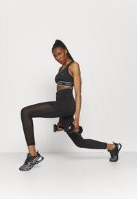 Calvin Klein Performance - MEDIUM SUPPORT BRA - Sportovní podprsenky se střední oporou - black - 1