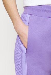CECILIE copenhagen - RAMONE  - Tracksuit bottoms - blueberry - 4