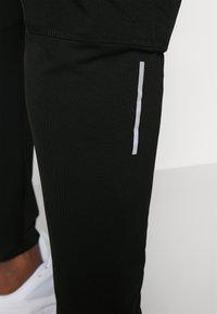 Nike Performance - Pantalon de survêtement - black - 3