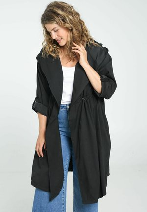 FLOWING - Trench - black