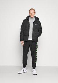 Nike Sportswear - Down jacket - black - 1