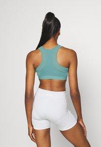 Even&Odd active - Medium support sports bra - light blue - 2