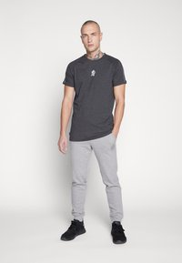 Jack & Jones - JJIGORDON  - Träningsbyxor - light grey melange - 1