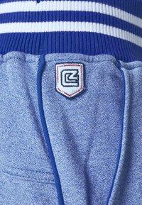 Schott - PAUL - Tracksuit bottoms - heather blue - 4