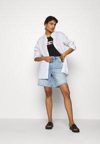 Calvin Klein Jeans - SMALL FLAG SLIM TEE - Print T-shirt - black - 1