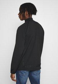 adidas Originals - WARMUP - Training jacket - black/goldmt - 2