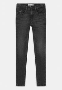 Calvin Klein Jeans - SUPER SKINNY MONOGRAM - Jeans Skinny Fit - black - 0
