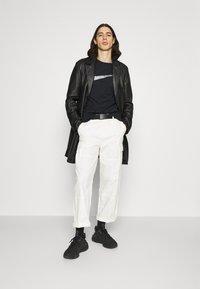 Nike Sportswear - TEE BRANDRIFF - T-shirt med print - black - 1