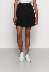 Calvin Klein Jeans - LOGO WAISTBANDSKIRT - Mini skirt -  black - 0