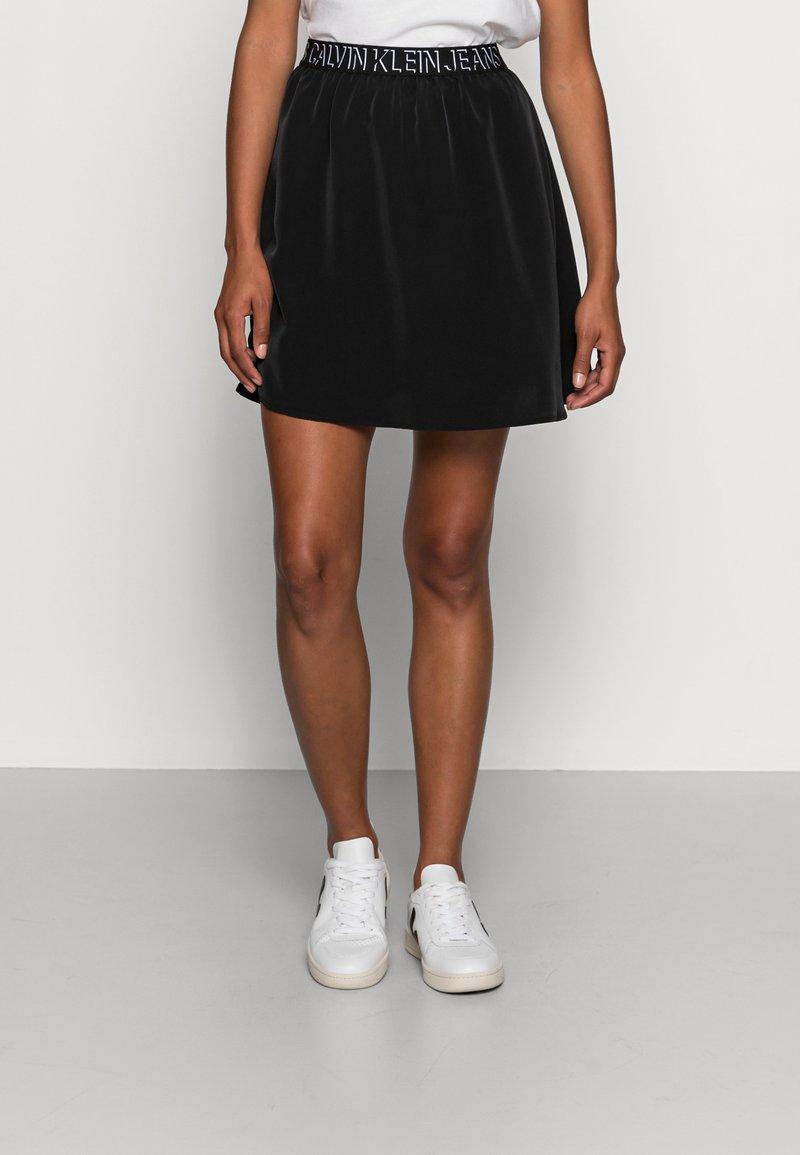 Calvin Klein Jeans - LOGO WAISTBANDSKIRT - Mini skirt -  black