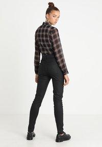 JDY - JDYELYN COATED - Jeans Skinny Fit - black - 2