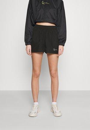 SMALL SIGNATURE - Shorts - black