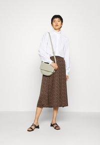 IVY & OAK - RUFFLE BLOUSE - Button-down blouse - bright white - 1