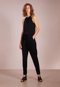 MICHAEL Michael Kors - ELEV CHAIN - Jumpsuit - black/silver - 0