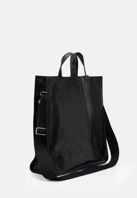 Steffen Schraut - SMUDGE - Shopping bags - black/yellow - 1