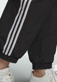 adidas Originals - Tracksuit bottoms - black - 3