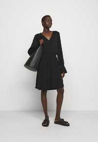 Holzweiler - RICA PLEAT DRESS - Day dress - black - 1