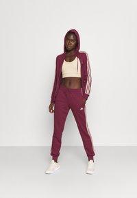 adidas Performance - Zip-up sweatshirt - victory crimson/halo blush - 1