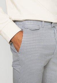 Topman - PUPSTOOTH SKINNY - Trousers - blue - 4