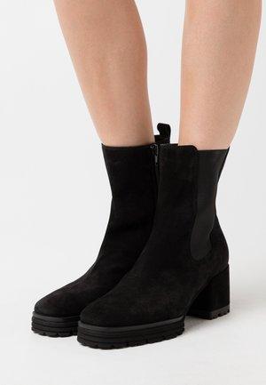JANE - Platform ankle boots - schwarz