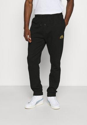 NORMAN PANTS - Teplákové kalhoty - black