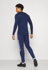 adidas Performance - TIRO 21 - Joggebukse - navy blue - 2