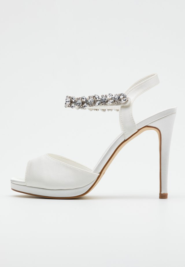 High heeled sandals - ivory