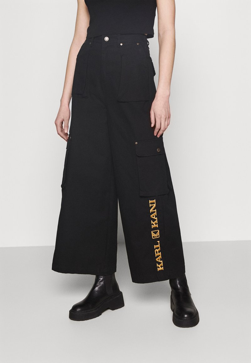 Karl Kani - RETRO BAGGY PANTS - Cargo trousers - black