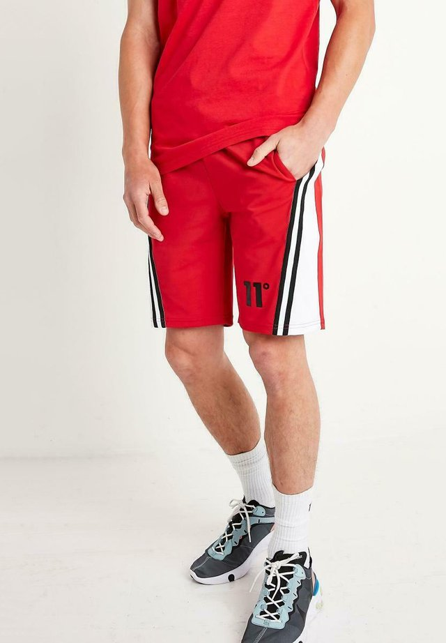 CUT AND TAPE DETAIL - Shorts - red whit
