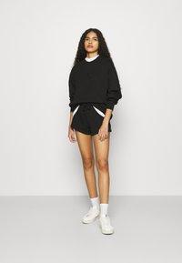 Calvin Klein Jeans - EMBROIDERY ECO WASH CREWNECK - Sweatshirt - black - 1