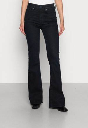 FLARE - Flared Jeans - worn in deep water
