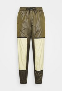 Nike Sportswear - WVN ARCHIVE RMX - Teplákové kalhoty - olive flak/tea tree mist/white - 3