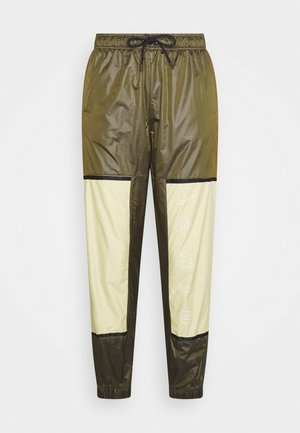 WVN ARCHIVE RMX - Tracksuit bottoms - olive flak/tea tree mist/white