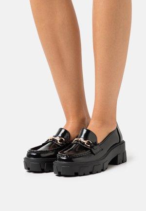 CARVER - Escarpins à plateforme - black