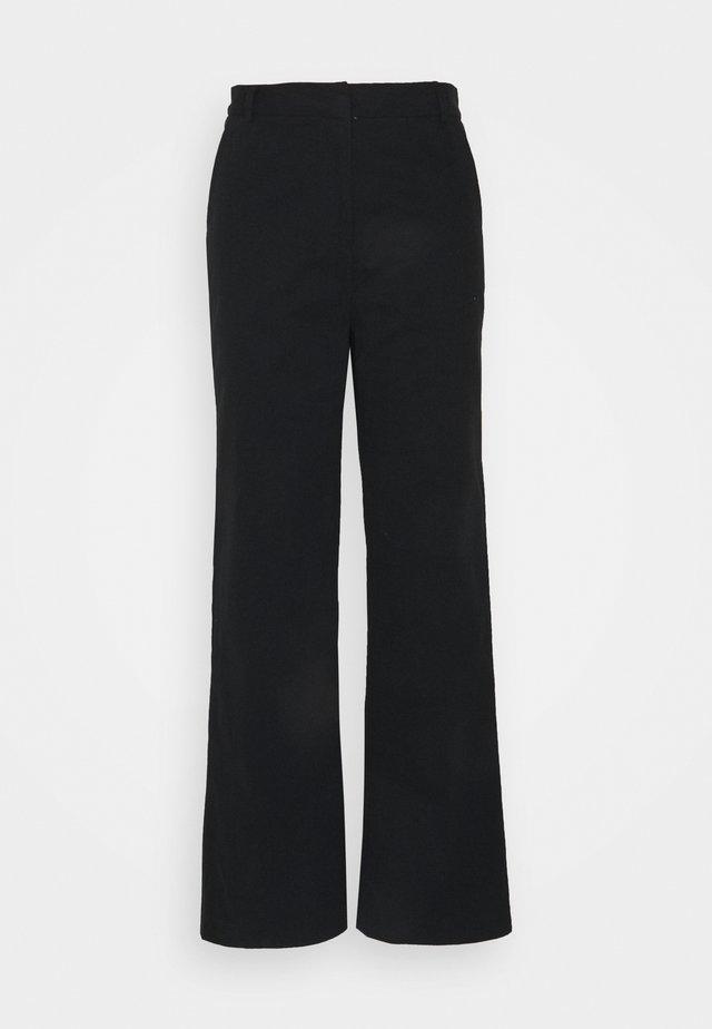 LEA PANTS - Pantaloni - black