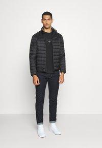 Calvin Klein - LIGHT WEIGHT SIDE LOGO JACKET - Kurtka przejściowa - black - 1