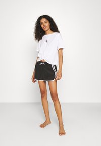 Calvin Klein Swimwear - CORE LOGO TAPE - Bikini bottoms - black - 1
