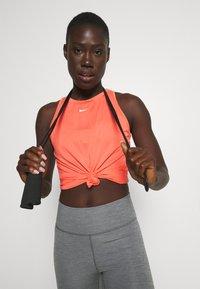 Nike Performance - ONE TANK - Top - magic ember/white - 3