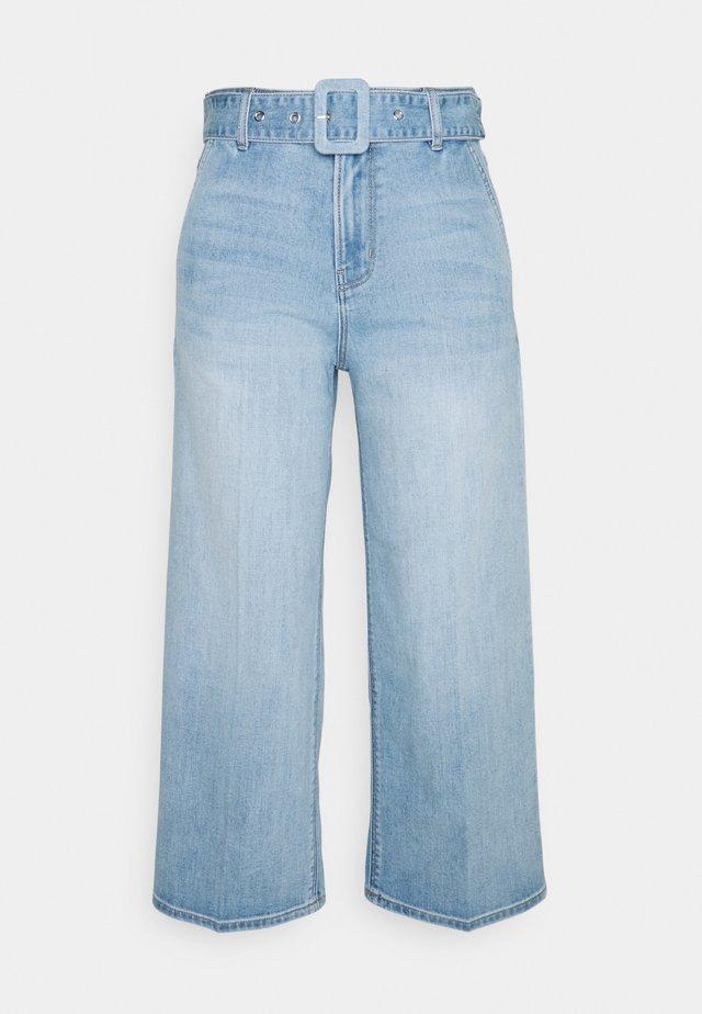 Jeans a zampa - blue lagoo