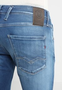 Replay - HYPERFLEX ANBASS - Slim fit jeans - dark blue denim - 3