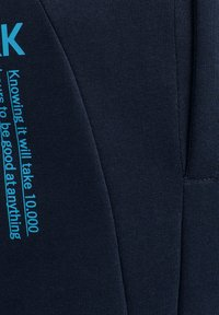 Hummel - HMLACTION  - Tracksuit bottoms - black iris/atomic blue - 3