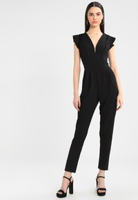 WAL G. - RUFFLE JUMPSUIT WITH BACK INSERT - Jumpsuit - black - 1